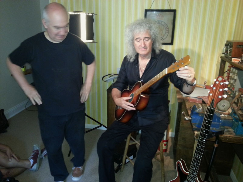 Brian tunes his Egmond while Queen's image archivist Richard Gray looks on Pic © S Bradley